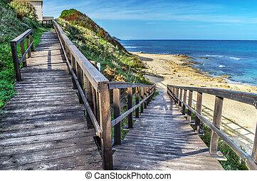 wooden boardwalk to the beach in Sardinia