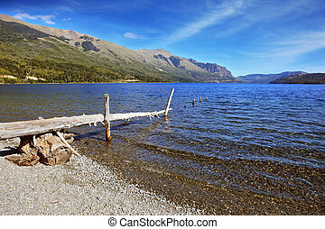 Wooden boat dock on the lake