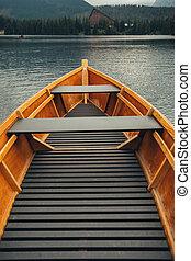 Wooden boat on a mountain lake Strbske pleso.