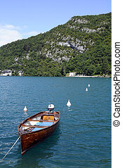 Wooden Boat on blue Annecy lake