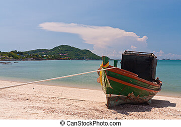 Wooden boat on the beach with blue sky