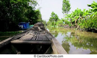 Wooden boat on the Mekong River - Vietnam, a wooden sailing...