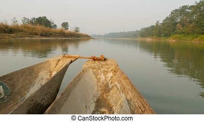 Wooden boat swimming in river of national park. Beak of...