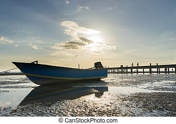 Wooden boat with reflect and bicycle on the bridge background sunset scene