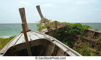 Wooden Boats, Abandoned and Rotting on a Beach in Thailand....