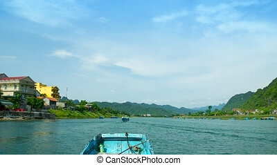 wooden boats float on tropical river with beautiful banks