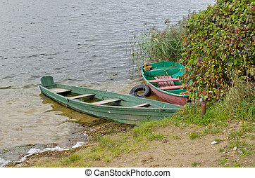wooden boats full water moored lake shore autumn