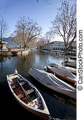 Wooden Boats line the Thiou Canal during the Winter, Annecy lake, France.
