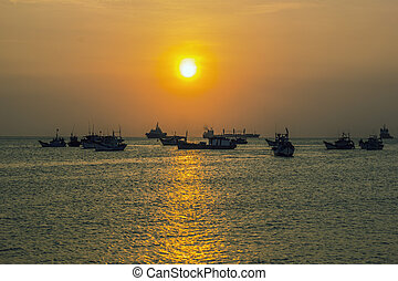 wooden boats on a sunset background