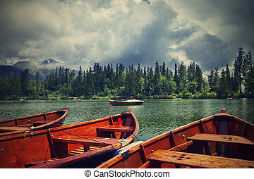 Wooden boats on lake