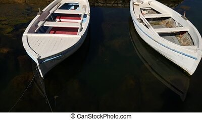 Wooden boats on the water. In the Bay of Kotor in Montenegro.