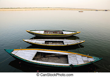 Wooden boats - Wooden country boats tied in a row on the ...