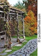 Wooden bower in autumn garden