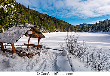 wooden bower in snowy winter spruce forest. beautiful...