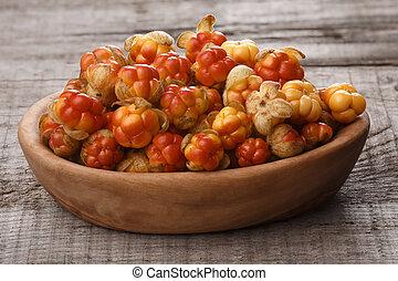 Wooden bowl of Cloudberries