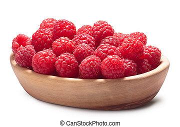 Wooden bowl of fresh raspberries