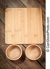 Wooden bowl on old wood background.