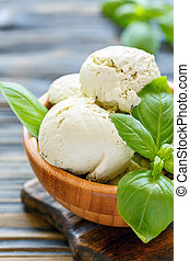 Wooden bowl with a refreshing basil ice cream.