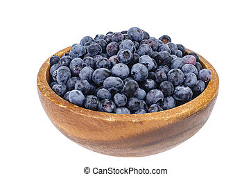 Wooden bowl with blue berry blueberry isolated on white background