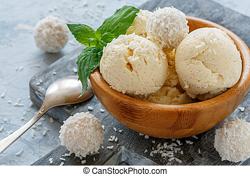 Wooden bowl with coconut ice cream.
