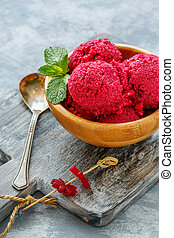 Wooden bowl with homemade beetroot ice cream.