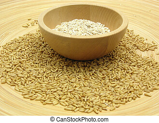Wooden bowl with oat flakes and corn on bamboo plate