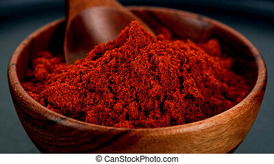 wooden bowl with red paprika