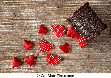 Wooden box and pile of hearts