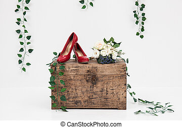 wooden box and red shoes with vine background