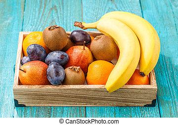 Wooden box of healthy fresh fruit