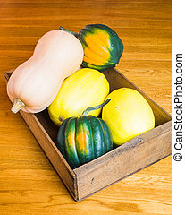 Wooden box of winter squash