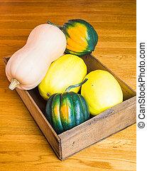 Wooden box of winter squash