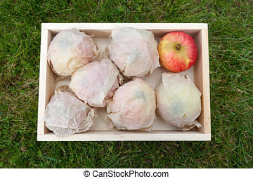 Wooden box with apples