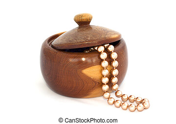 Wooden box with beads on white background