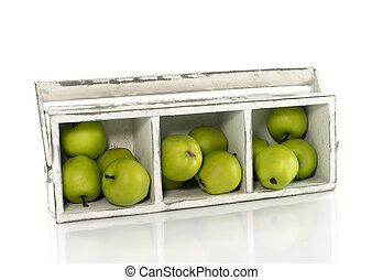 wooden box with green apples