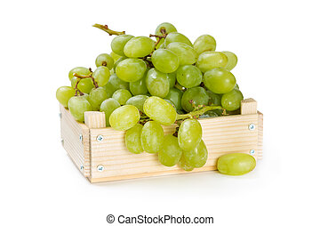 Wooden box with green grapes