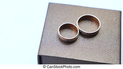 Wooden box with luxury wedding rings