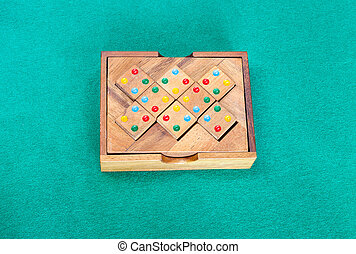 wooden box with puzzle on green table - wooden box with ...