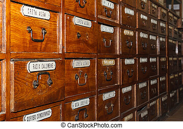 Wooden boxes for medicines in the old pharmacy with...