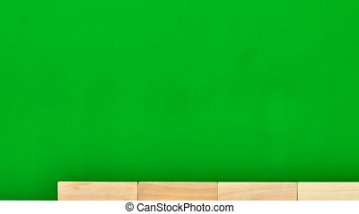 Wooden bricks are gathered into wall. Stop motion, green screen