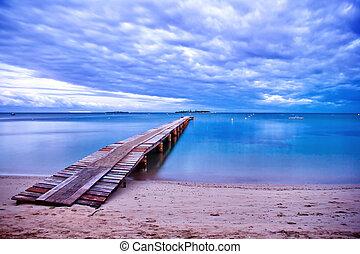 Wooden Bridge - A wooden bridge in New Caledonia beach.