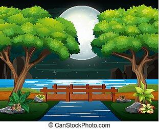 Wooden bridge across the river in night landscape