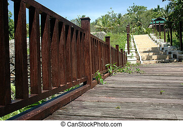 wooden bridge and concrete stairs in a park