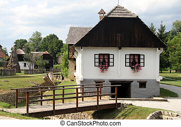 Wooden bridge and house - Wooden bridge and farm house in...