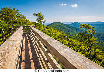 Wooden bridge and view of the Appalachian Mountains from Big Schloss, in George Washington National Forest, Virginia.