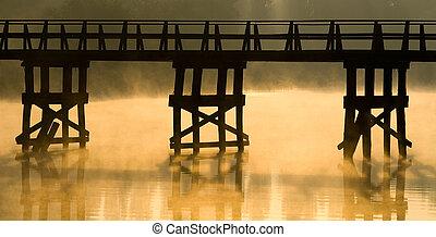 Wooden bridge at dawn