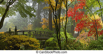 Wooden Bridge at Japanese Garden in Autumn Panorama - Wooden...