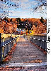 Wooden bridge at sunset