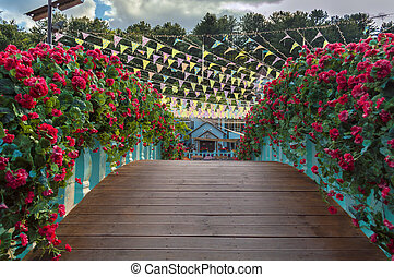 wooden bridge decorated with red geranium