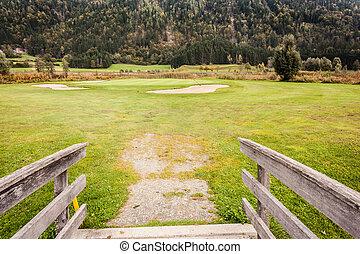 Wooden bridge in golf course